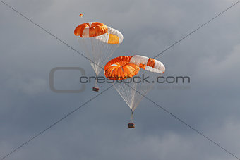Freights on parachutes go down the earth