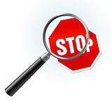 Stop Sign under magnifying glass