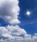 Blue sky with white clouds and sun