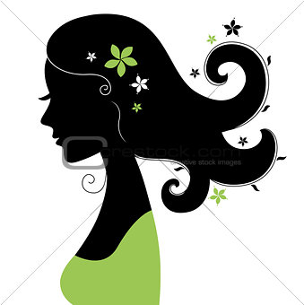 Beautiful woman silhouette with flowers in hair