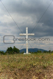Old cross in the field.
