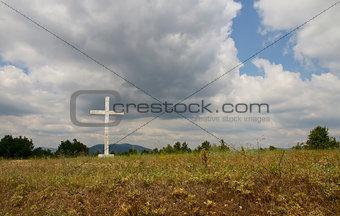Old cross in the field.