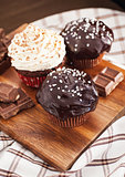 Chocolate cupcakes decorated with glaze and cream