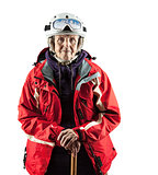 Senior woman in ski jacket and helmet over white. With clipping path.