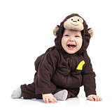 Baby boy dressed in monkey costume over white
