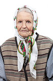 Portrait of a senior woman in headscarf looking at the camera. Over white background.