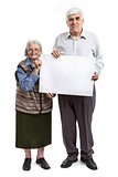 Senior woman and mature man holding holding a blank billboard isolated on white background