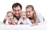 Closeup of young family with two baby boys against white background