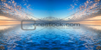 Beautiful syk reflected in calm sea waters