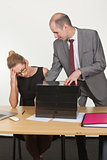 Dominant boss giving lots of work to his assistant
