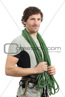 Attractive rock climber posing with harness and cord
