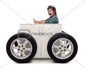 Young motorist - boy playing