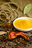 Turmeric in saucer with spices and paprika