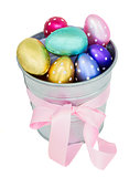 multicolored easter eggs in metal  pot