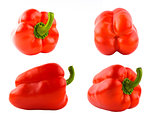 Four red sweet peppers set different sides