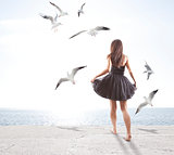Young girl with seagulls