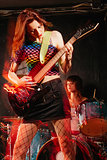 Women playing rock music on stage