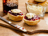 Two scones with clotted cream and jam