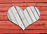 Heart carved on a wooden surface