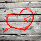 Red heart painted on a wooden surface