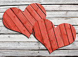 Two heart carved on a wooden surface