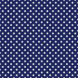 Seamless vector pattern with white polka dots on a sailor navy blue background.