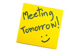 "Sticky note with text ""Meeting Tomorrow"""