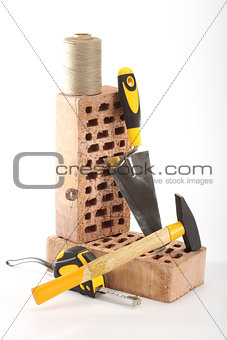 Bricks, trowel and hammer