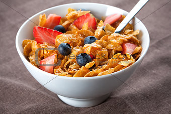 Bowl of corn flakes and berries