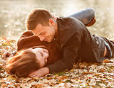 young couple lying down smiling