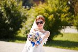 Happy bride outside.