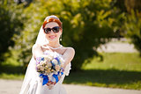 Happy bride outside.