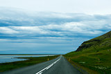Road against mountain background, Iceland, cloudy summer weather