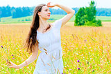 slender beautiful girl in flower field