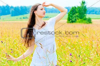 slender beautiful girl in flower field
