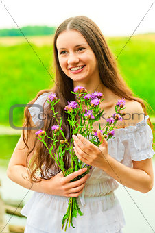 beautiful smiling happy girl with a bouquet