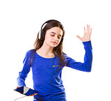 Smiling girl listening to music on digital tablet