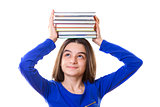 Young girl with stack of books on her head