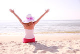 girl wearing hat on the beach