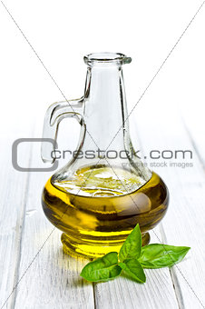 olive oil with basil leaves