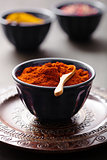 spices in bowls: curry pink and black pepper paprika powder