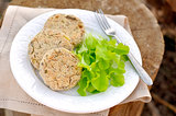 Potato and buckwheat patties served with salad leaves