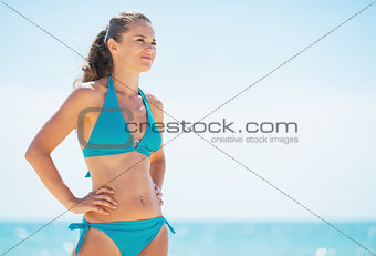 Portrait of young woman looking on copy space on beach