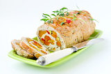 Baked turkey roll stuffed with dried apricots, cherries and pist