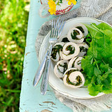 Chicken fillet rolls with fresh greens served with salad leaves