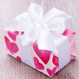 Pretty Valentines gift with hearts on the giftwrap