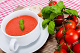 tasty fresh tomato soup basil and bread