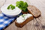 yoghurt creamy cheese with herbs and bread
