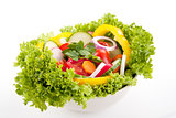 fresh tasty mixed salad with different vegetables isolated