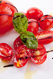 fresh red tomatoes with balsamic and oilve oil isolated